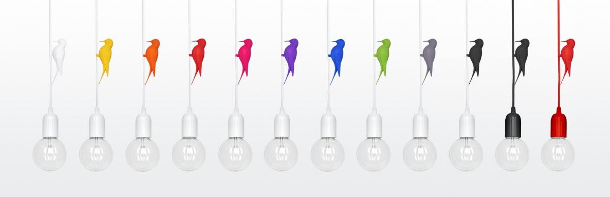 row of diferent color 3D printed birds clipped on fabric cables of suspended bulb pendant lights